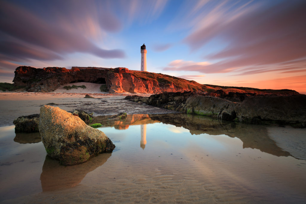 Lighthouse and sea view at sunset