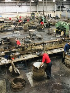 Shows a Cooper working in whisky barrel Speyside Cooperage