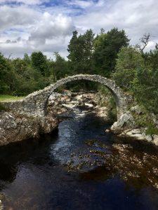 300 year old Packhorse Bridge in Carrbridge in October in Moray