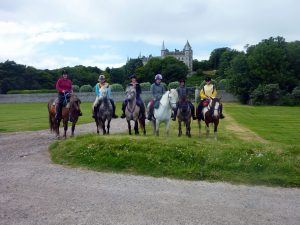 Horse Riding in Scotland with Dunrobin Castle in the Background